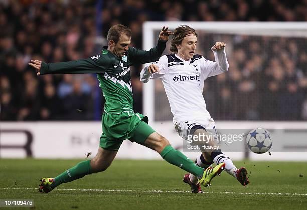 Luka Modric of Tottenham Hotspur is challenged by Daniel Jensen of Werder Bremen during the UEFA Champions League Group A match between Tottenham...