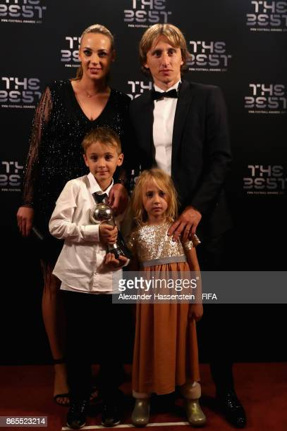 Luka Modric with family poses for a photo after The Best FIFA Football Awards at The London Palladium on October 23 2017 in London England