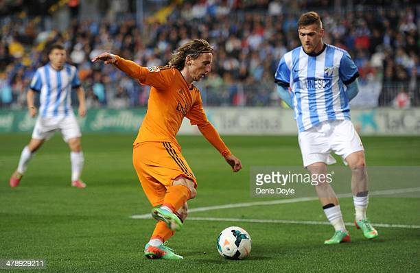 Luka Mordic of Real Madrid takes on Ignacio Camacho of Malaga during the La Liga match between Malaga and Real Madrid at La Rosaleda Stadium on March...