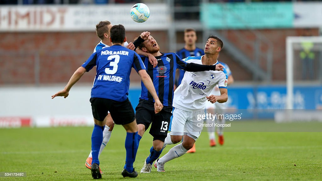Luka Tankulic of Sportfreunde Lotte (R) and Michael Fink of Mannheim (L) go up for a header during the Third League play-off first leg match between SF Lotte and Waldhof Mannheim at Sportpark am Lotter Kreuz on May 25, 2016 in Lotte, Germany.