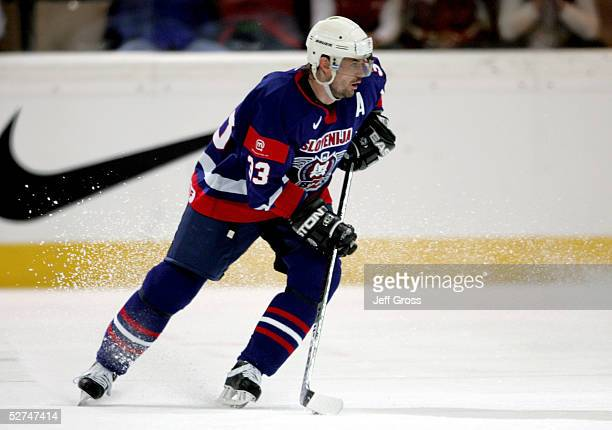 Luka Zagar of Slovenia skates with the puck against the USA in the IIHF World Men's Championships preliminary round game at the Olympic Hall on May 1...
