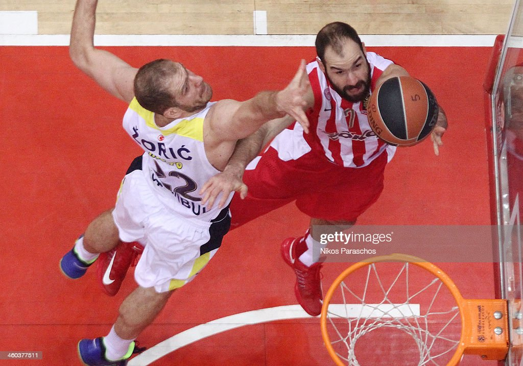 Luka Zoric, #22 of Fenerbahce Ulker Istanbul competes with <a gi-track='captionPersonalityLinkClicked' href=/galleries/search?phrase=Vassilis+Spanoulis&family=editorial&specificpeople=704857 ng-click='$event.stopPropagation()'>Vassilis Spanoulis</a>, #7 of Olympiacos Piraeus during the 2013-2014 Turkish Airlines Euroleague Top 16 Date 1 game between Olympiacos Piraeus v Fenerbahce Ulker Istanbul at Peace and Friendship Stadium on January 3, 2014 in Athens, Greece.