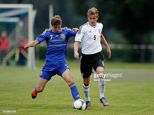 Lukas Boeder of Germany battles for the ball with Mykhallo Kostenko of Ukraine during the U16 International Friendly match between Germany and...
