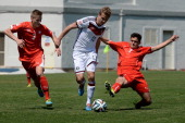 Lukas Boeder of Germany is challenged by Tobias Schaettin and Arxhend Cani of Switzerland during the UEFA Under17 European Championship 2014 group B...