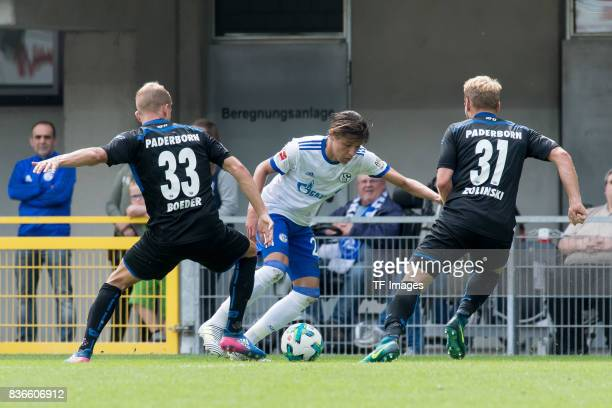 Lukas Boeder of Paderborn Amine Harit of Schalke and Ben Zolinski of Paderborn battle for the ball during the preseason friendly match between SC...
