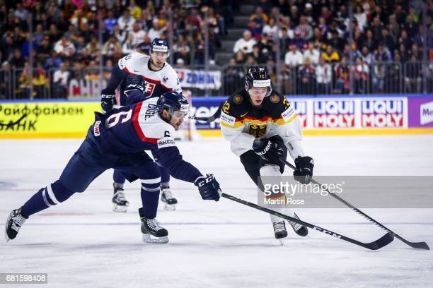Lukas Cingel of Slovakia challenges Dominik Kahun of Germany for the puck during the 2017 IIHF Ice Hockey World Championship game between Germany and...