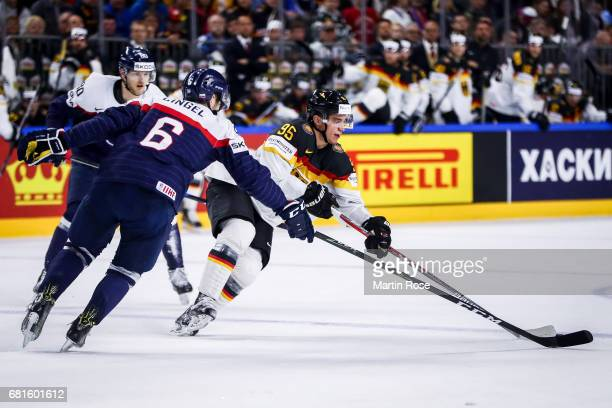 Lukas Cingel of Slovakia challenges Frederik Tiffels of Germany for the puck during the 2017 IIHF Ice Hockey World Championship game between Germany...