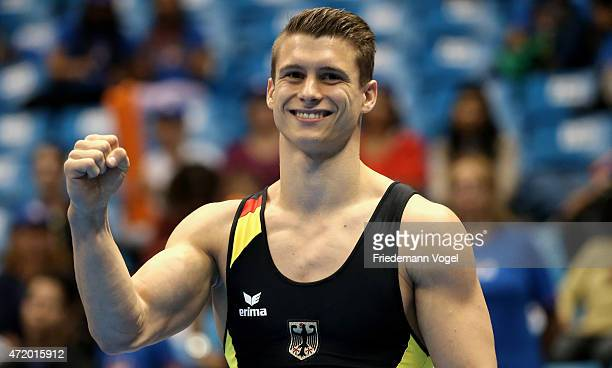 Lukas Dauser of Germany celebrates on the podium after winning the Parallel Bars competition during day one of the Gymnastics World Challenge Cup...