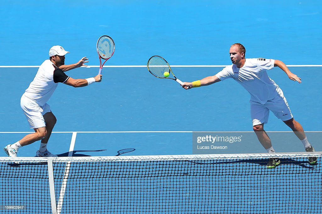 Lukas Dloughy of the Czech Republic plays a forehand in his fourth round doubles match with Daniele Bracciali of Italy against Mike Bryan of the United States and Bob Bryan of the United States during day ten of the 2013 Australian Open at Melbourne Park on January 23, 2013 in Melbourne, Australia.