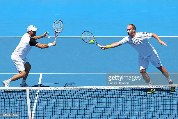 Lukas Dloughy of the Czech Republic plays a forehand in his fourth round doubles match with Daniele Bracciali of Italy against Mike Bryan of the...