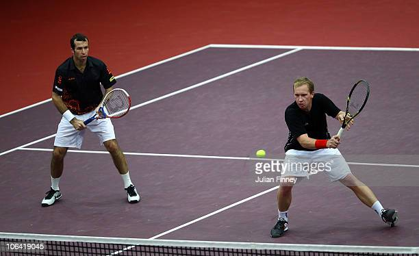 Lukas Dlouhy and Radek Stepanek of Czech Republic in action against Simon Aspelin of Sweden and Paul Hanley of Australia in the doubles during Day...