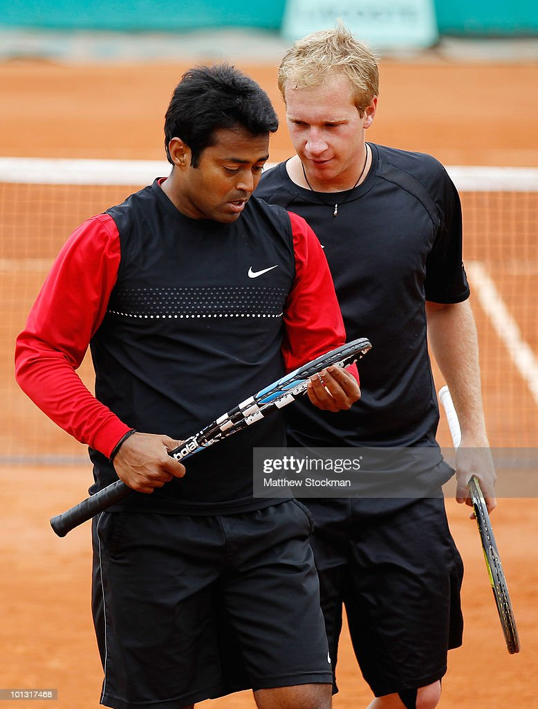Lukas Dlouhy of Czech Republic and Leander Paes of India in action during the men's doubles fourth round match bweteen Lukas Dlouhy of Czech Republic...