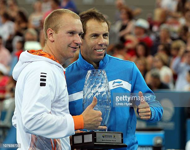 Lukas Dlouhy of Czech Republic and Paul Hanley pose with the winners trophy after winning the Men's doubles final match during day eight of the...