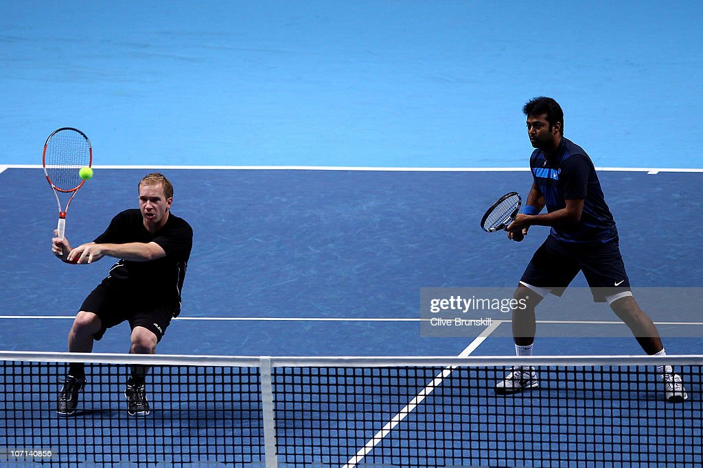 Lukas Dlouhy of Czech Republic returns a shot while playing with Leander Paes of India during their men's doubles match against Mike Bryan and Bob...