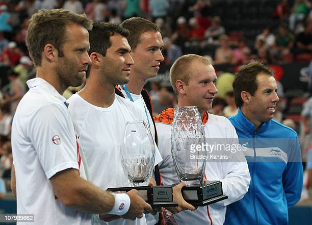 Lukas Dlouhy of the Czech Republic and Paul Hanley of Australia hold the winners trophy as they celebrate victory after their doubles finals match...