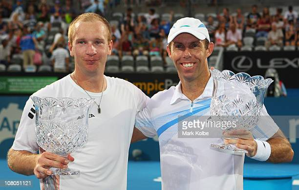 Lukas Dlouhy of the Czech Republic and Paul Hanley of the Australia pose with their trophies after winning the men's doubles final match against Bob...