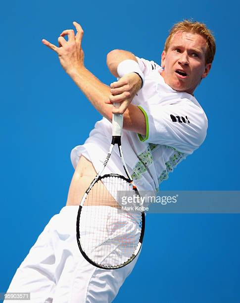 Lukas Dlouhy of the Czech Republic plays a forehand in his first round doubles match with Leander Paes of India against Leos Friedl and David Skoch...