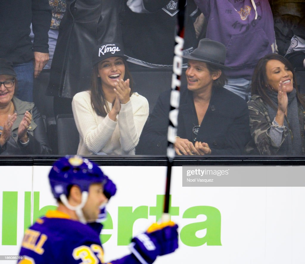 <a gi-track='captionPersonalityLinkClicked' href=/galleries/search?phrase=Lukas+Haas&family=editorial&specificpeople=239113 ng-click='$event.stopPropagation()'>Lukas Haas</a> (R) attends a hockey game between the Edmonton Oilers and the Los Angeles Kings at Staples Center on October 27, 2013 in Los Angeles, California.