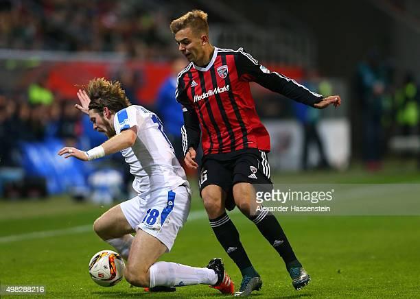 Lukas Hinterseer of Ingolstadt battles for the ball with Peter Niemeyer of Darmstadt during the Bundesliga match between FC Ingolstadt and SV...