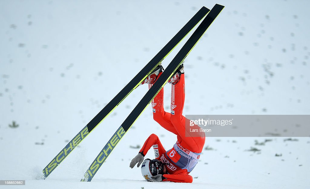 Lukas Hlava of Czech Republic falls down during the final round first leg of the FIS Ski Jumping World Cup event at the 61st Four Hills ski jumping tournament at Olympiaschanze on January 1, 2013 in Garmisch-Partenkirchen, Germany.