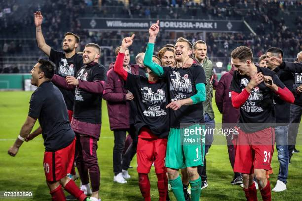 Lukas Hradecky goal keeper of Frankfurt celebrates with a team after the DFB Cup semi final match between Borussia Moenchengladbach and Eintracht...