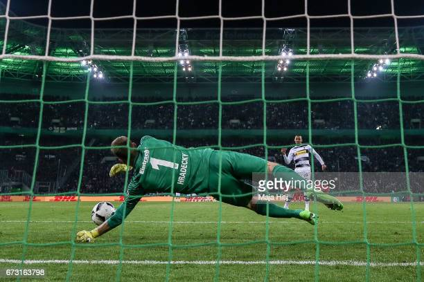 Lukas Hradecky goal keeper of Frankfurt holds a ball of Djibril Sow of Moenchengladbach during penalty shoot out during the DFB Cup semi final match...