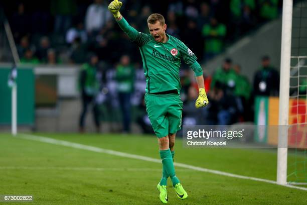 Lukas Hradecky goalkeeper of Moenchengladbach celebrates during penalty shoot out during the DFB Cup semi final match between Borussia...