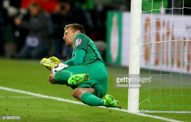 Lukas Hradecky goalkkeper of Moenchengladbach makes a save during penalty shoot out during the DFB Cup semi final match between Borussia...