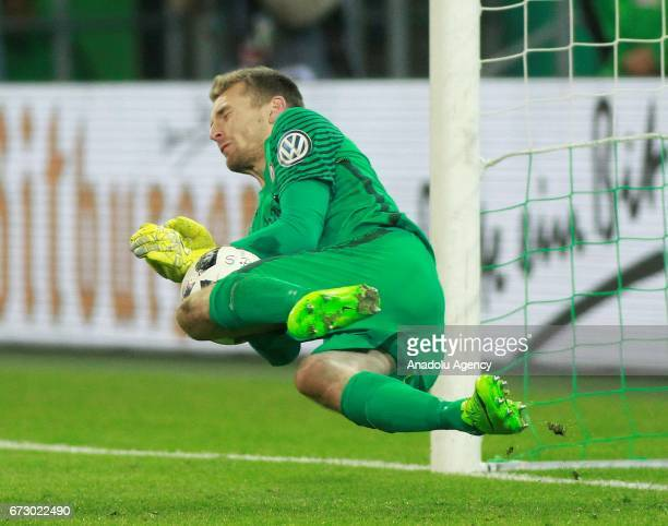 Lukas Hradecky of Eintrach Frankfurt holds a penalty shot during shootouts of the DFB Cup semifinal soccer match between Borussia Monchengladbach and...