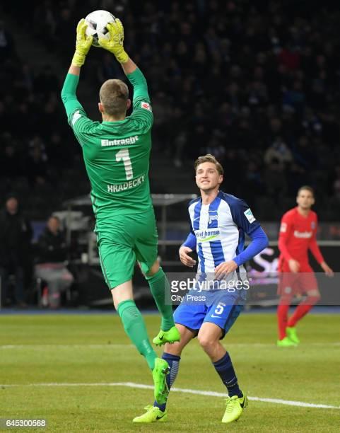 Lukas Hradecky of Eintracht Frankfurt and Niklas Stark of Hertha BSC during the game between Hertha BSC and the Eintracht Frankfurt on february 25...