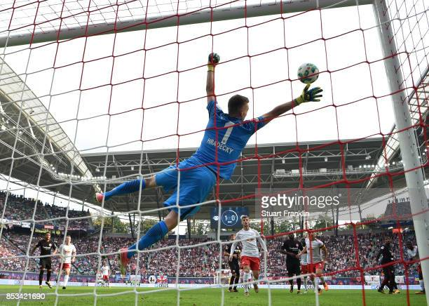 Lukas Hradecky of Frankfurt dives during the Bundesliga match between RB Leipzig and Eintracht Frankfurt at Red Bull Arena on September 23 2017 in...