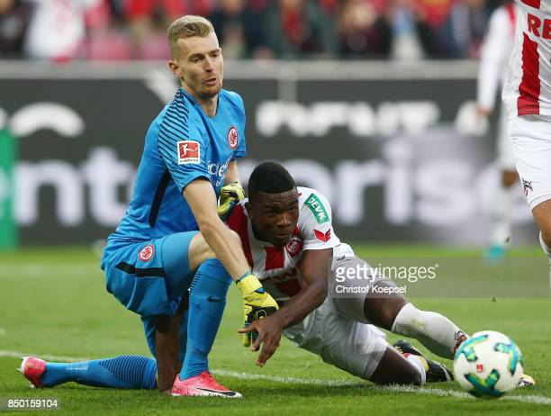 Lukas Hradecky of Frankfurt fights for the ball with Jhon Cordoba of Koeln during the Bundesliga match between 1 FC Koeln and Eintracht Frankfurt at...