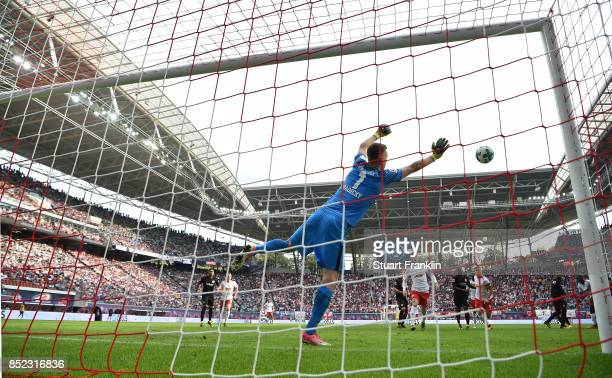 Lukas Hradecky of Frankfurt saves a shot on his goal during the Bundesliga match between RB Leipzig and Eintracht Frankfurt at Red Bull Arena on...