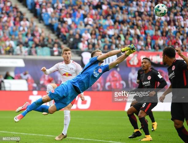 Lukas Hradecky of Frankfurt saves against Timo Werner of Leipzig during the Bundesliga match between RB Leipzig and Eintracht Frankfurt at Red Bull...