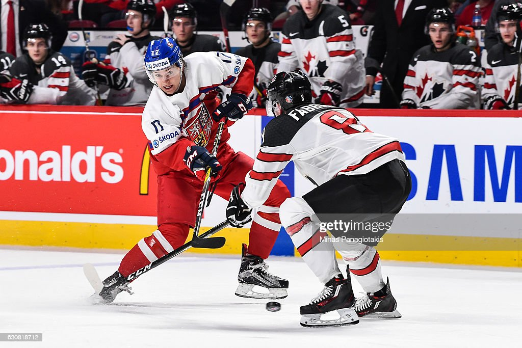 Lukas Jasek #17 of Team Czech Republic takes a shot near Dante Fabbro #8 of Team Canada during the 2017 IIHF World Junior Championship quarterfinal game at the Bell Centre on January 2, 2017 in Montreal, Quebec, Canada. Team Canada defeated Team Czech Republic 5-3.