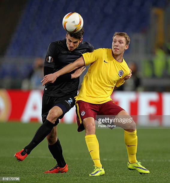 Lukas Julis of Sparta Prague competes for the ball with Wesley Hoedt of SS Lazio during the UEFA Europa League Round of 16 second leg match between...