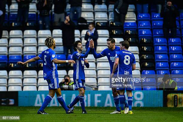 Lukas Jutkiewicz of Birmingham City celebrates with teammates Stephen Gleeson Diego Fabbrini and Ryan Shotton after scoring the equalising goal...
