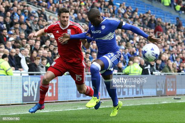 Lukas Jutkiewicz of Birmingham City is challenged by Sol Bamba of Cardiff City during the Sky Bet Championship match between Cardiff City and...