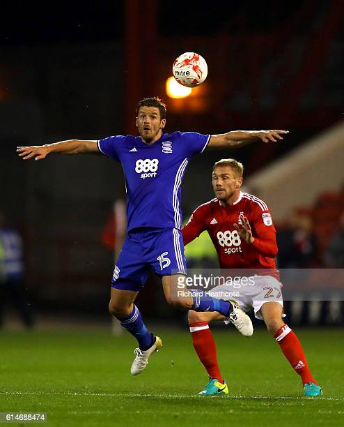 Lukas Jutkiewicz of Birmingham holds off Damien Perquis of Forest during the Sky Bet Championship match between Nottingham Forest and Birmingham City...
