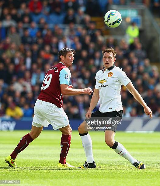 Lukas Jutkiewicz of Burnley and Phil Jones of Manchester United compete for the ball during the Barclays Premier League match between Burnley and...