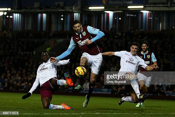 Lukas Jutkiewicz of Burnley battles for the ball with Aly Cissokho and Ciaran Clark of Aston Villa during the Barclays Premier League match between...