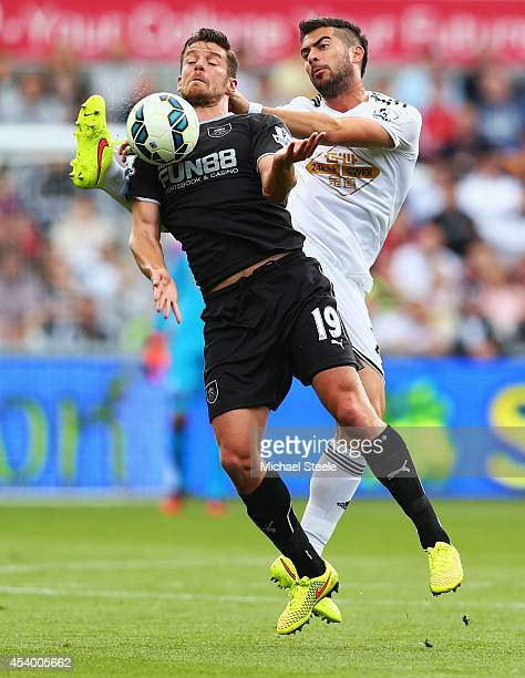 Lukas Jutkiewicz of Burnley holds off Jordi Amat of Swansea City during the Barclays Premier League match between Swansea City and Burnley at Liberty...