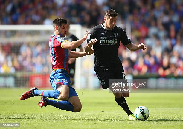 Lukas Jutkiewicz of Burnley is challenged by Scott Dann of Crystal Palace during the Barclays Premier League match between Crystal Palace and Burnley...