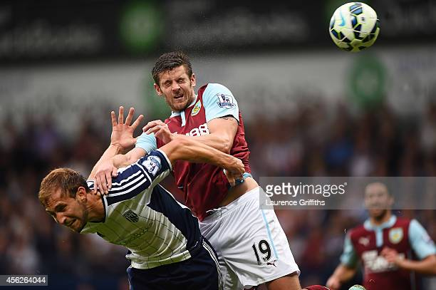 Lukas Jutkiewicz of Burnley jumps for the ball with Craig Dawson of West Brom during the Barclays Premier League match between West Bromwich Albion...