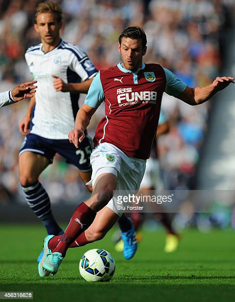 Lukas Jutkiewicz of Burnley outpaces Craig Dawson of WBA during the Barclays Premier League match between West Bromwich Albion and Burnley at The...