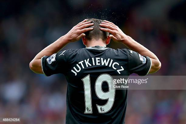 Lukas Jutkiewicz of Burnley reacts after missing a scoring chance during the Barclays Premier League match between Crystal Palace and Burnley at...