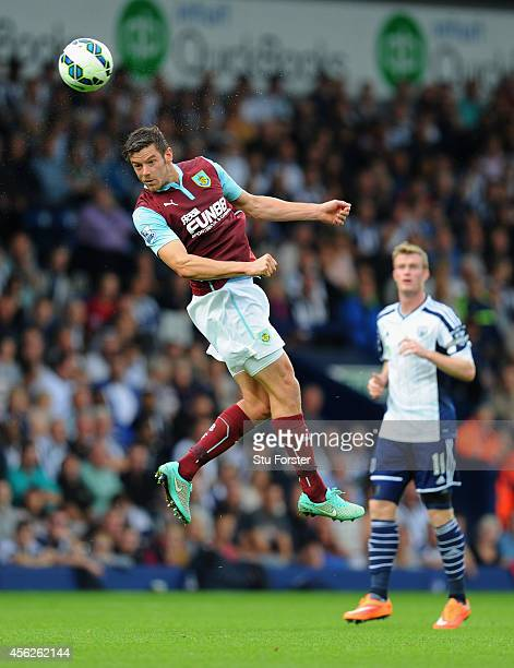 Lukas Jutkiewicz of Burnley wins a header during the Barclays Premier League match between West Bromwich Albion and Burnley at The Hawthorns on...