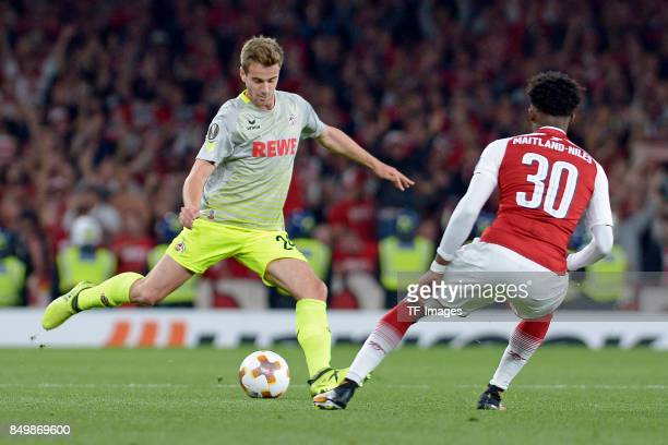 Lukas Klünter of Koeln Ainsley MaitlandNiles of Arsenal battle for the ball during the UEFA Europa League group H match between Arsenal FC and 1 FC...