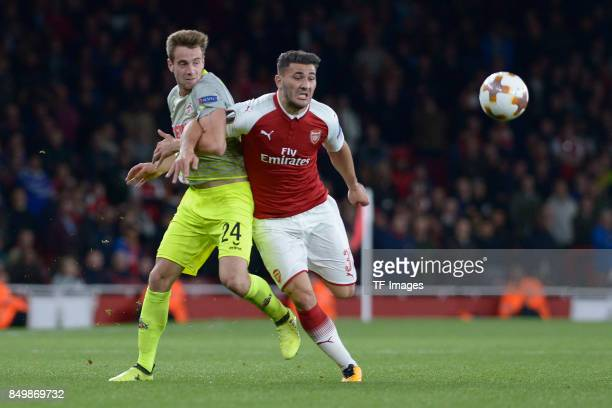 Lukas Klünter of Koeln Sead Kolasinac of Arsenal battle for the ball during the UEFA Europa League group H match between Arsenal FC and 1 FC Koeln at...