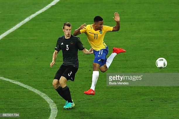 Lukas Klostermann of Germany and Gabriel Jesus of Brazil challenge for the ball during the Men's Football Final between Brazil and Germany at the...